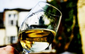 White wine swirling in a crystal glass outdoors